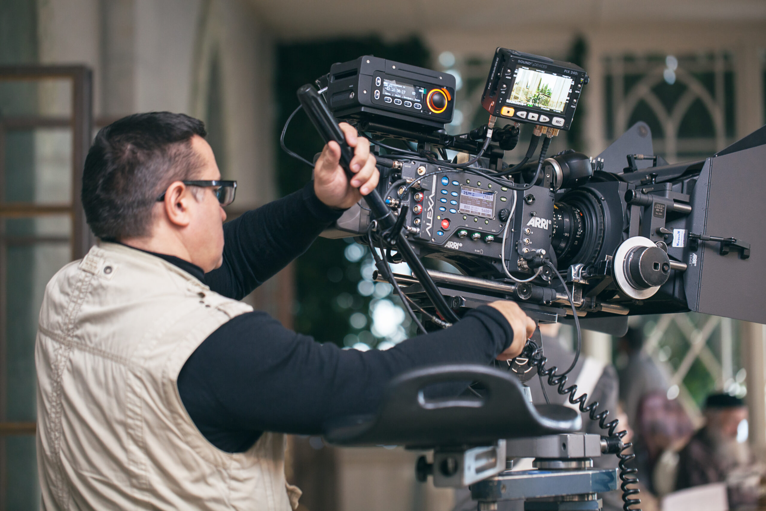 MOSCOW, RUSSIA - DECEMBER 9, 2014:  Professional cameraman working with modern equipment during filming of Not Yet Evening by Marlen Khutsiev